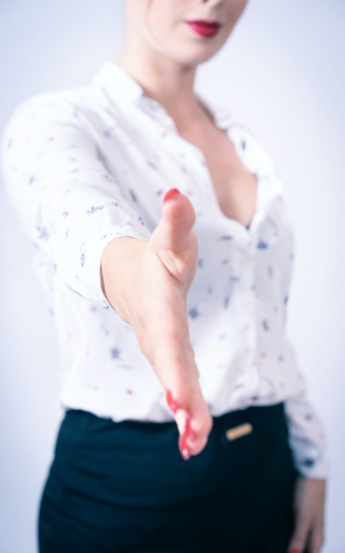 woman-wearing-white-top-with-hand-reaching-out-2822647